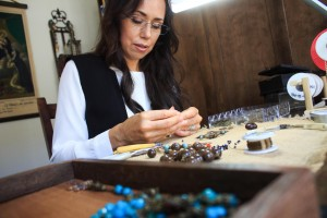 Rosary designer Arasely Rios works on a rosary in her Temecula studio. Rios has been chosen by Catholics participating in Pope Francis's visit to the U.S. to handcraft a rosary that will be given to him upon his arrival. Photo by Shane Gibson